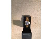 Gold sekonda watch