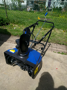 Snow thrower by snow joe