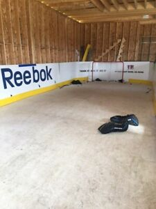 Synthetic hockey rink with boards