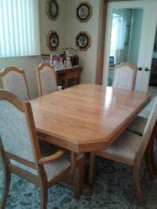New Price** $200.00 Beautiful Light Oak Dining Room Suite.