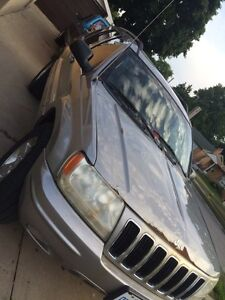 2002 jeep grand cherokee 4.7l open to trades