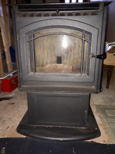 Pellet Stove, M55-FS. There are a few pipes included.