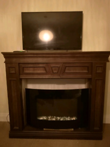 Electric Fireplace with full mantle. Comes apart. Also decorativ