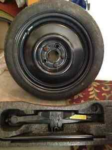 Spare Donut/Jack for 1997 Chevy Cavalier or Equivalent vehicle Windsor Region Ontario image 1