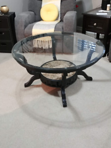 Coffee table. Round with glass top.