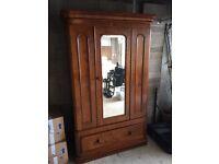 Beautiful vintage wooden wardrobe with mirror door