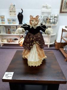 vintage porcelain cat doll in victorian dress