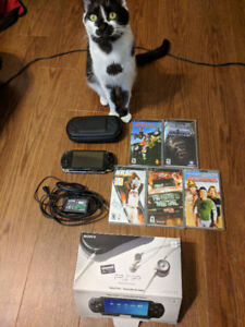 PSP-1001- 4 games + movie, in original box with all accessories