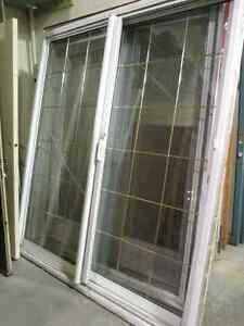 Beautiful Sliding Patio Doors with Brass Grill