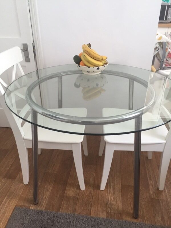 Ikea salmi round glass dining table in hammersmith for Ikea round dining tables