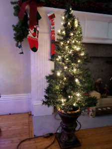 Pre-lit 4' Noma Potted Christmas Tree. Indoor/outdoor.