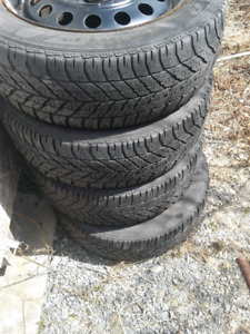 Four steel rims and winter tires &hubcaps