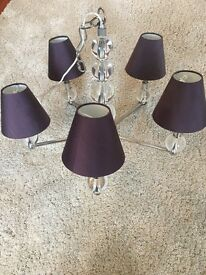 Glass ceiling chandelier with purple shades
