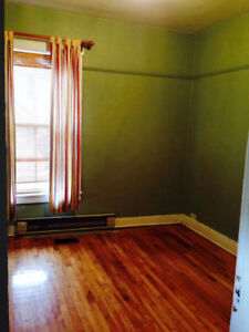 Large two bedroom, featuring a large sun room downtown!!