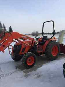 Kioti DS4510 tractor with backhoe attachment