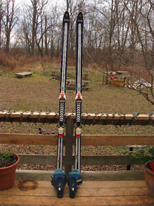 Assortment of Used Downhill Skis, Boots, and Poles