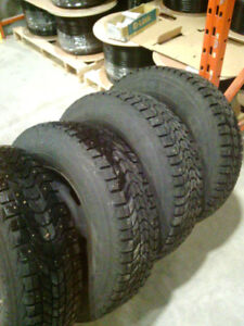 P235 75 r15 Firestone Winter force studded tires and rims Ranger