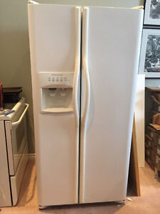 Side by side refrigerator with water and ice despenser