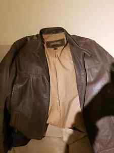 Danier M unisex leather jacket in mint condition  London Ontario image 1