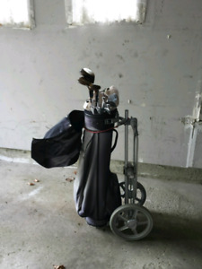Golf clubs with bag and caddy