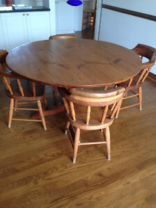 REDUCED — Pine Dining Table and 4 captain's chairs (as is)