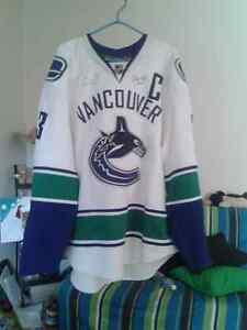 Vancouver Canucks Jersey signed by Henrik Sedin and 2 others