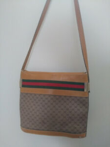 Gucci Vintage 1970s brown leather monogram metallic accents