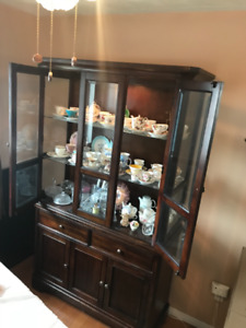 China cabinet with China. Light inside. 6 foot by 4 foot.