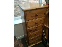 Wooden chest of drawers .