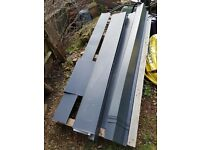 Metal sheet roofing, flashings, ridge, barge roof, eaves.