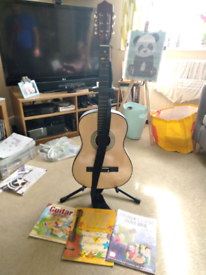 3/4 guitar, stand and books