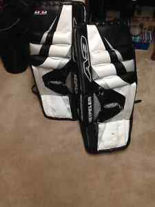 Hockey gear and assorted sticks