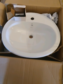 New RAK ceramic sink with chrome push up waste trap