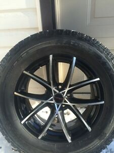 Ford rims and tires basically new !