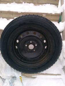 4 Like new Toyo winter tires on steel rims
