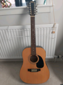 Stagg 12 string guitar and a bag
