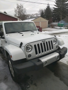 2015 Jeep Wrangler unlimited Sahara for sale or loan take over