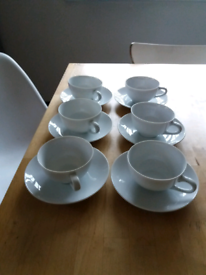 White china cups and saucers.