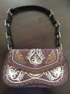 Brown suede patterned Guess purse with leather buckle strap