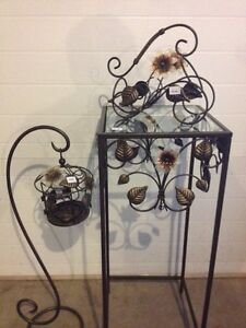 Candle holder, wine bottle holder and table trio