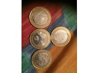 4 £2 coins with backwards inscribing on the side