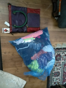 Brand new purse and bag of girl clothes . Size med -small