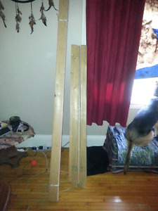 For sale 2 2x4s and 6 slatts for a queen size bed