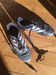 Women size 6 Adidas soccer cleats, pink stripes.