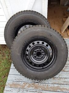 225 X 70 X 16 studded winter tires with rims less than 10000 KM