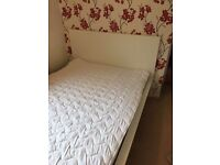 White Malm Ikea double bed frame with mattress.