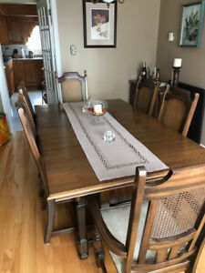 Dining room table, sideboard and hutch with 8 chairs
