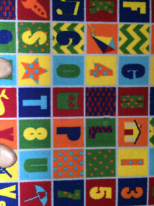 Childs playroom area rug or bedroom rug in mint condition