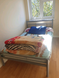 2 x beds - 1 x double wood and 1 x single metal