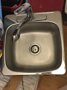 Farely new kitchen sink and modern faucet